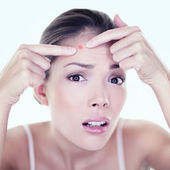 Girl pressing on skin problem face — Stock Photo