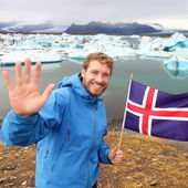 Tourist showing Icelandic flag — Stock Photo