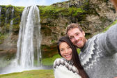 Couple making selfie in Icelandic sweaters — Stock Photo