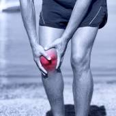 Male runner with pain from sprain knee — Stock Photo