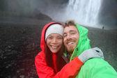 Couple taking selfie by waterfall — Foto Stock