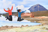 People jumping of joy in nature — Stock Photo