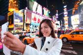 Woman taking photo in New York — Stock Photo