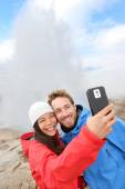 Tourists making selfie by Strokkur geyser — Stock Photo