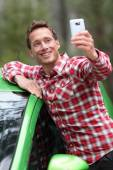 Driver by car taking selfie — Stock Photo