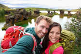 Travel couple on lake Myvatn Iceland — Photo