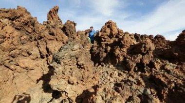 Hiking couple walking volcano — Stockvideo
