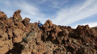 Hiking man walking on volcano — Stockvideo