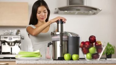 Woman using juicer machine — Stock Video