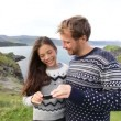 Couple on using smartphone app on Iceland — Stock Video #72646817