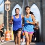 New York runners running on Brooklyn bridge — Stock Photo #72653239