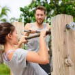 Fitness couple training on chin-up bar — Stock Photo #72653439