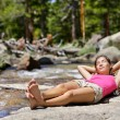 Woman relaxing alone by river creek — Stock Photo #72654095