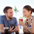 Couple on cafe looking at smart phone — Stock Photo #72654131