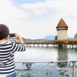 Tourist taking photograph in Lucerne — Stock Photo #72654249