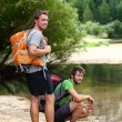 Hiking men resting after long hike — Stock Photo #72654467