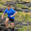 Man trail running on volcanic rocks — Stock Photo #72654483