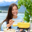 Woman eating local Swiss food — Stock Photo #72654623