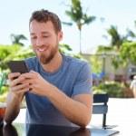 Man on cafe using smart phone — Stock Photo #72654627