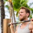 Man working out pull-ups on chin-up bar — Stock Photo #72654767