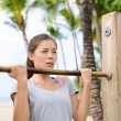 Fitness woman exercising on chin-up bar — Stock Photo #72655083