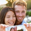 Couple in love taking selfie with smartphone — Stock Photo #72655381