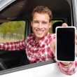 Man driving car showing Smartphone — Stock Photo #72655527