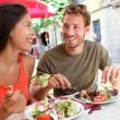 Tourists couple eating at outdoor cafe — Stock Photo #72655629