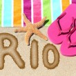 Word RIO written on golden sand — Stock Photo #72655815