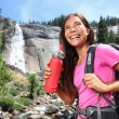 Healthy hiker girl drinking water — Stock Photo #72655973