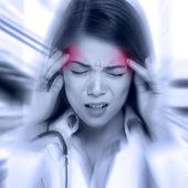 Woman with pounding headache — Stock Photo