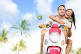 Free young couple on scooter — Stock fotografie