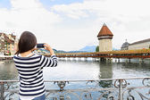 Tourist taking photograph in Lucerne — Stock Photo