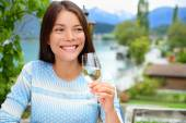 Woman smiling and raises her glass — Stock Photo