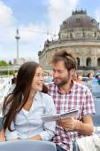 Couple reading travel book on Berlin boat — Stock Photo