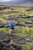 Male ultra runner in nature landscape — Stock Photo