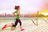 Woman runner and Hong Kong skyline — Foto de Stock