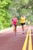 People running on road — Stock Photo