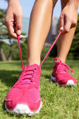 Runner getting ready tying running shoes laces — Stock Photo
