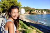 Tourist woman on beach in Mallorca — Stock Photo