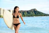 Surfer woman on Waikiki Beach — Stock Photo