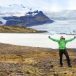 Man cheering on hike on Iceland — Stock Photo #73836895