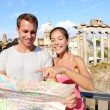 Tourists holding map by Roman Forum — Stock Photo #73837875