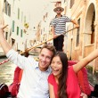 Happy couple in Venice gondola — Stock Photo #73838595