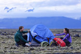 People pitching tent on Iceland at dusk — Stock Photo