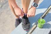 Female runner tying shoe laces — Stock Photo