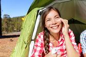 Camping woman applying sunscreen — Stock Photo