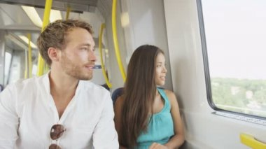 Couple sitting in public transport — Stock Video