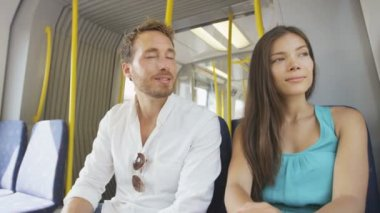 Commuters sitting in transport smiling — Stock Video
