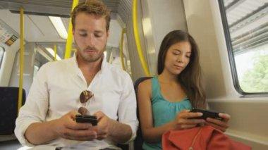 Passengers using smartphone in public transportation — Stock Video